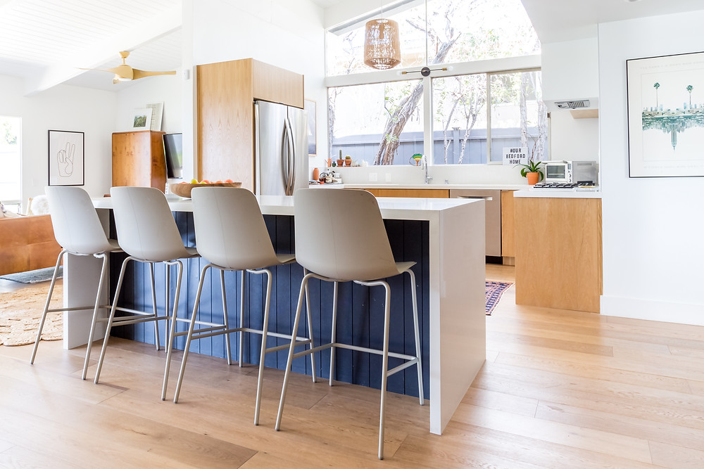 Midcentury renovation with an open plan kitchen and island by Veneer Designs
