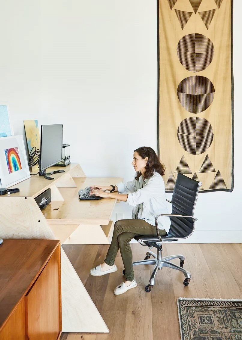 Designer at work in her home office desk