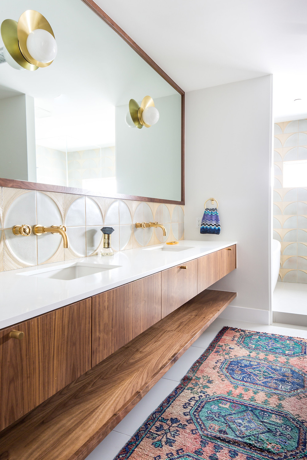 Master bathroom with floating walnut vanity cabinet and open shelf