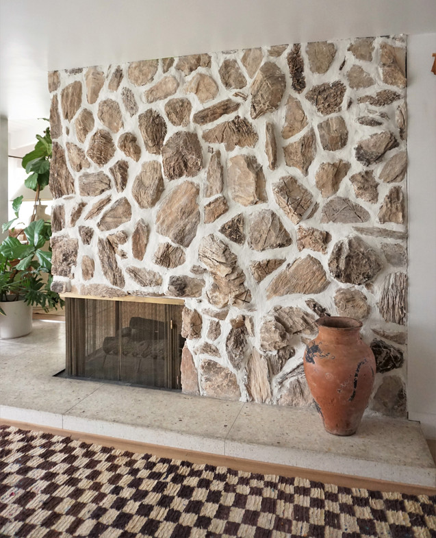overgrouted stone fireplace