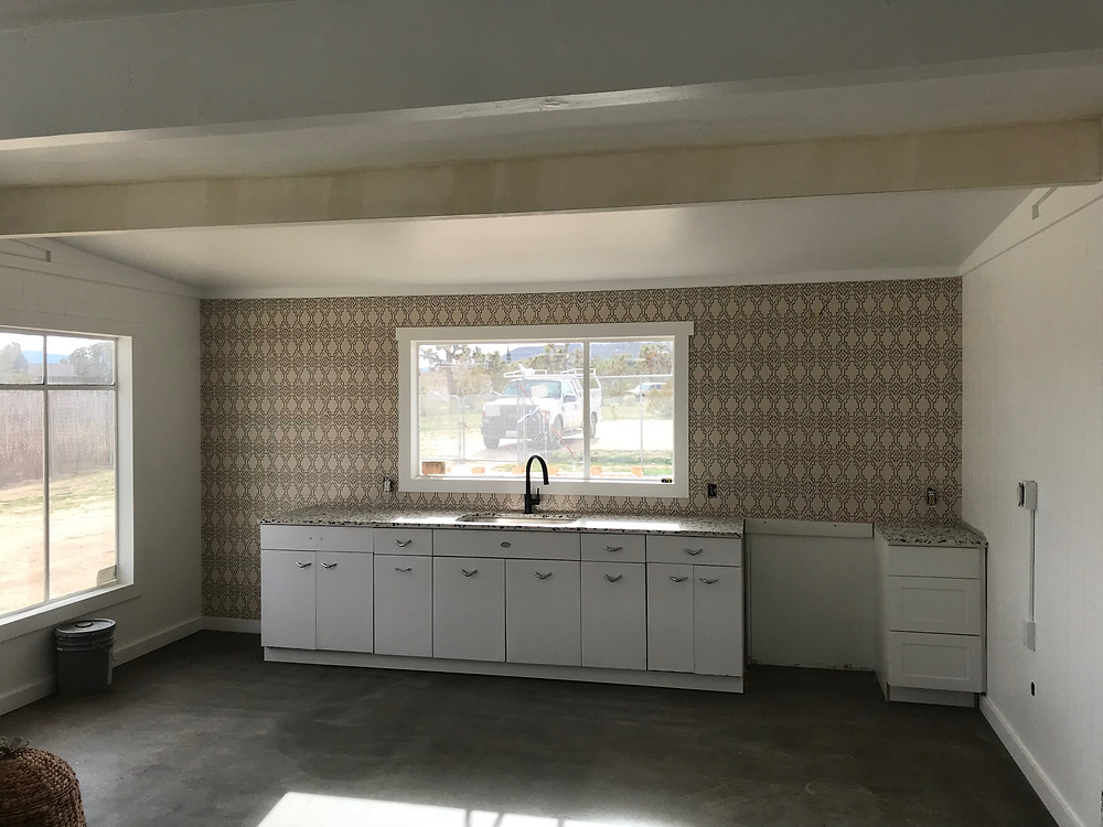 Kitchen with new counters and tile backsplash
