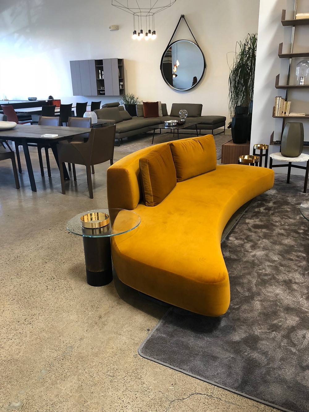 Yellow curvilinear sofa at the NIDO Living