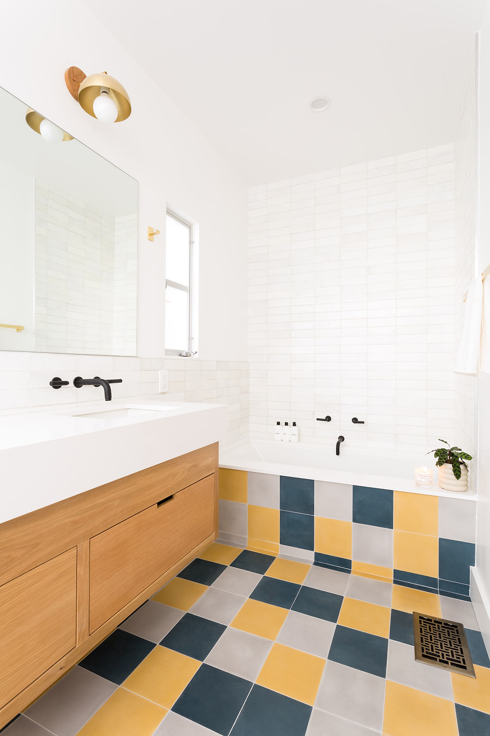 Bathroom remodel with colorful floor tile squares