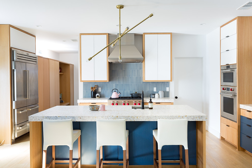 Modern open kitchen with blue island and tile