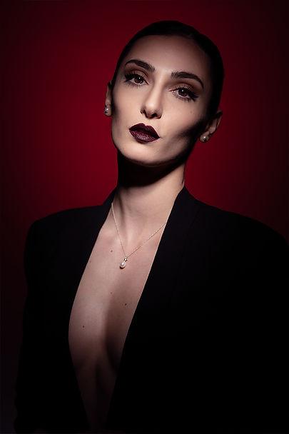 Reza hadian photography pixrez beauty portrait red dark makeup shot with single moody light photoshoot in London