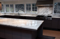 Neolith counter tops with full backsplash and Island