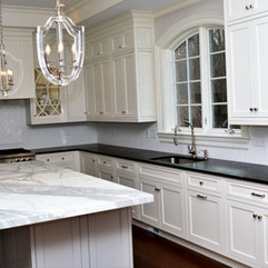 Black Absolute hone finish counter tops with Statuarietto Honed Marble Island