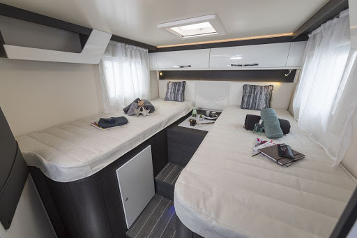 Fixed beds at rear