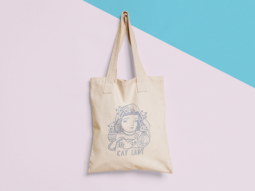tote-bag-mockup-hanging-from-a-nail-on-a-two-colors-wall-a15313 (1).png