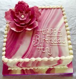 pink swirl flower cake