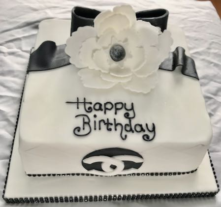 Chanel bow & flower birthday cake