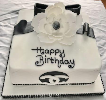 Chanel bow & flower birthday cake