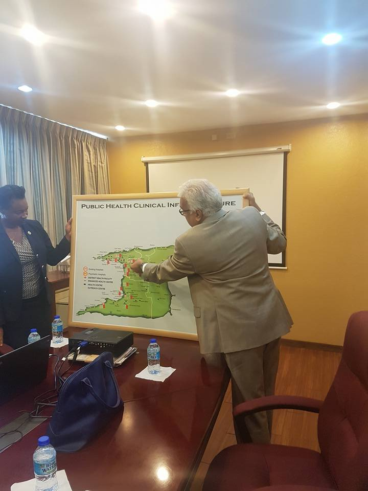 The Honourable Terrence Deyalsingh, Minister Health demonstrates some points to the visiting Spelman