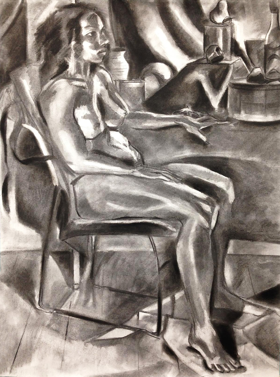 "9.  ""Alex Sitting in Chair"" Charcoal on paper 24"" x 18"" 2018"