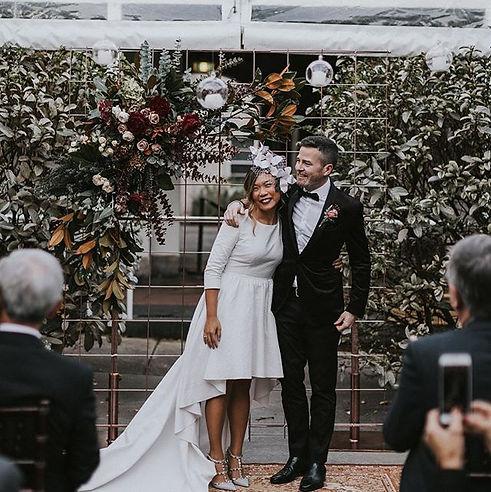Bride wearing modern French designer wedding dress