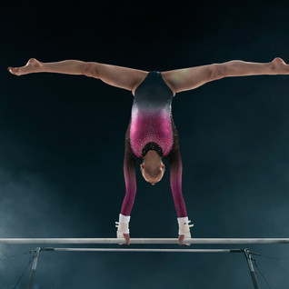 Female gymnast doing a complicated trick