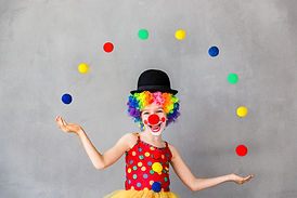 Let's celebrate! Funny kid clown. Child