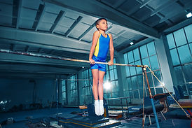 The little boy is engaged in sports gymn