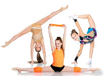 Group of cheerful gymnast girls performi