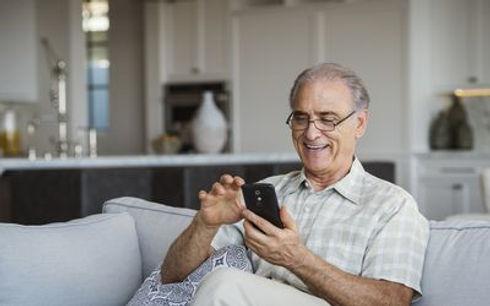 senior-citizen-using-phone-5c36495f46e0f