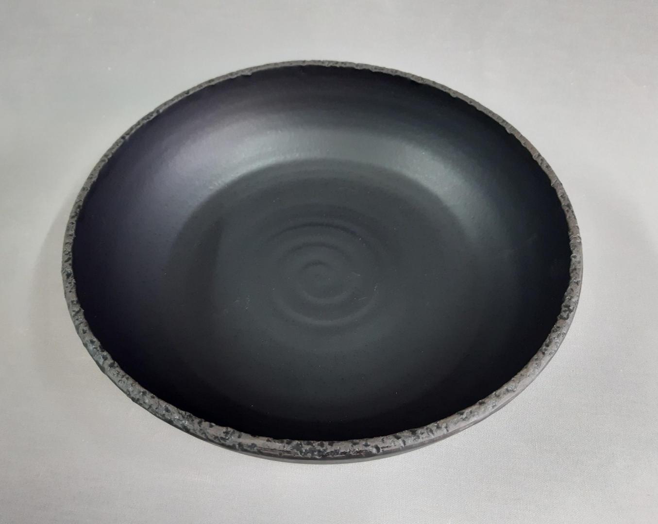 Big black rough edge bowl