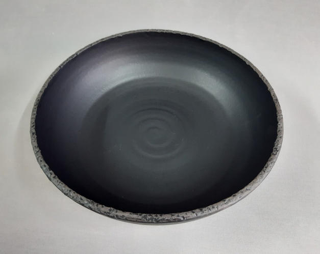 Big black rough edge bowl