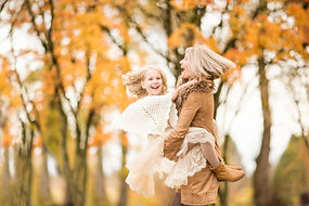 Rochelle and niece Aurielle playing in the fall leaves.