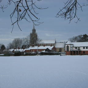 View of Church from Recreation Ground, East Harling, January 2010