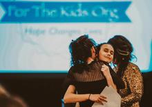 thumbnail_Rachel hugging mom at gala.jpg