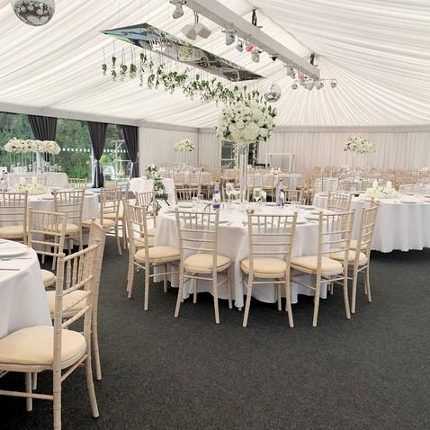 White wedding theme setup with Chivari Chairs