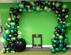 Black Friday Jungle Themed Balloon Arch.jpeg