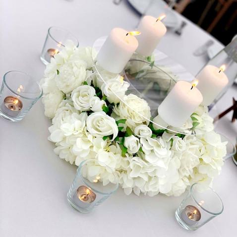 Short white wedding centrepiece