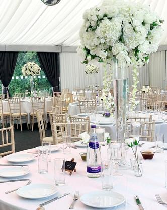 Tall white wedding centrepiece