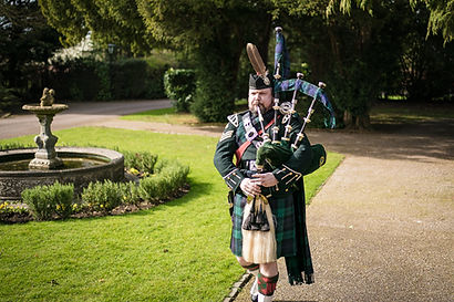 Andrew Brian Highland Bagpiper Funeral piper for hire