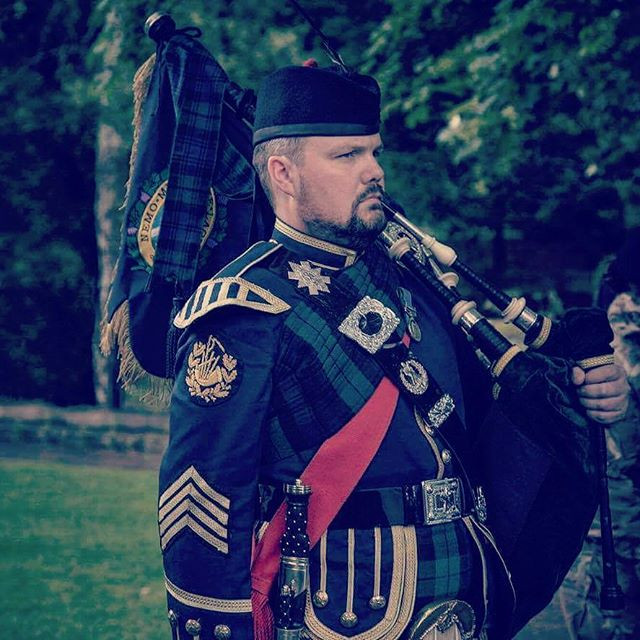 Piping for a D day veterans funeral a sh
