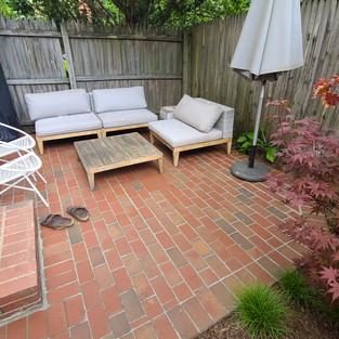 New brick patio in oasis garden
