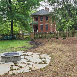 custom built natural stone patio, firepit and native landscape