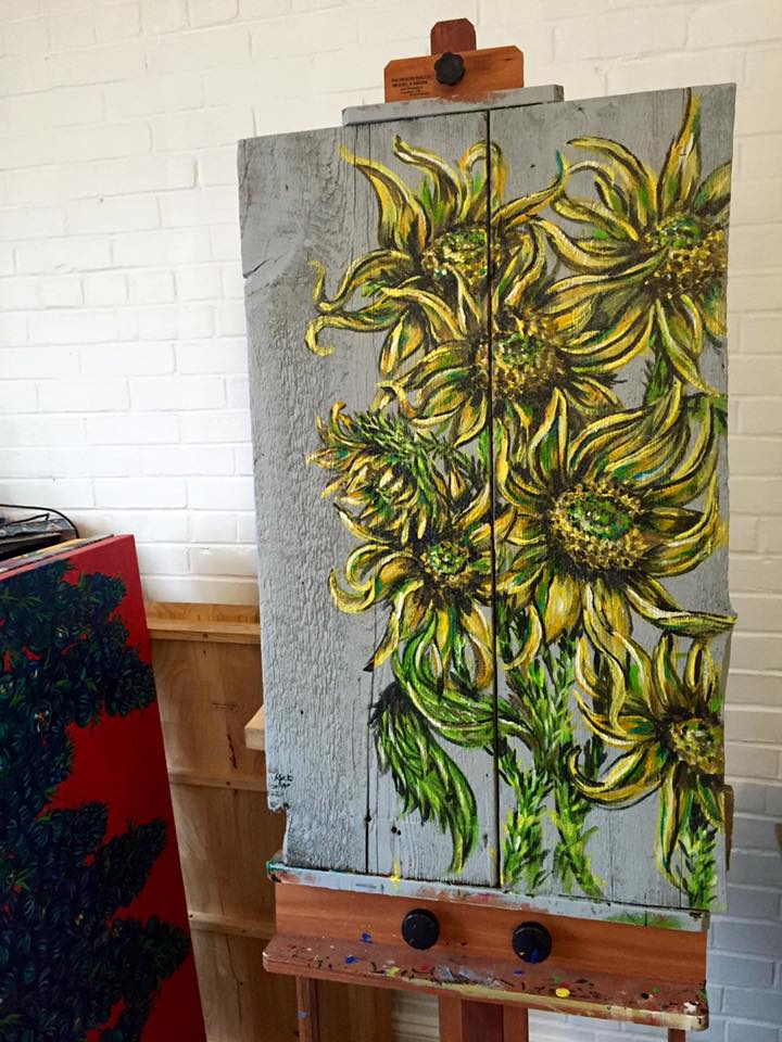 sunflowers on old barn wood