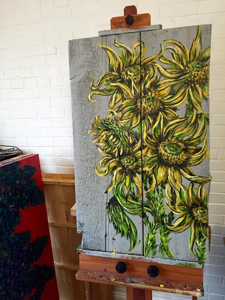 sunflowers on old barn wood