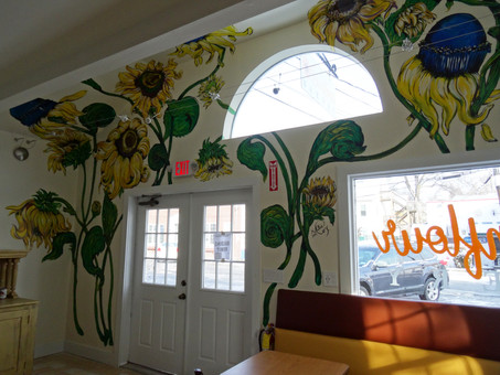 Sunflowers + Black-eyed Susans growing in a bakery in New York
