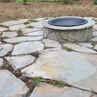 custom built natural stone patio and firepit