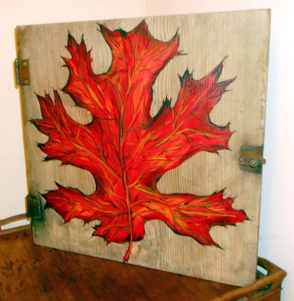 Red oak leaf on old barn door