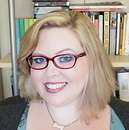 Head shot: A blonde woman wearing glasses