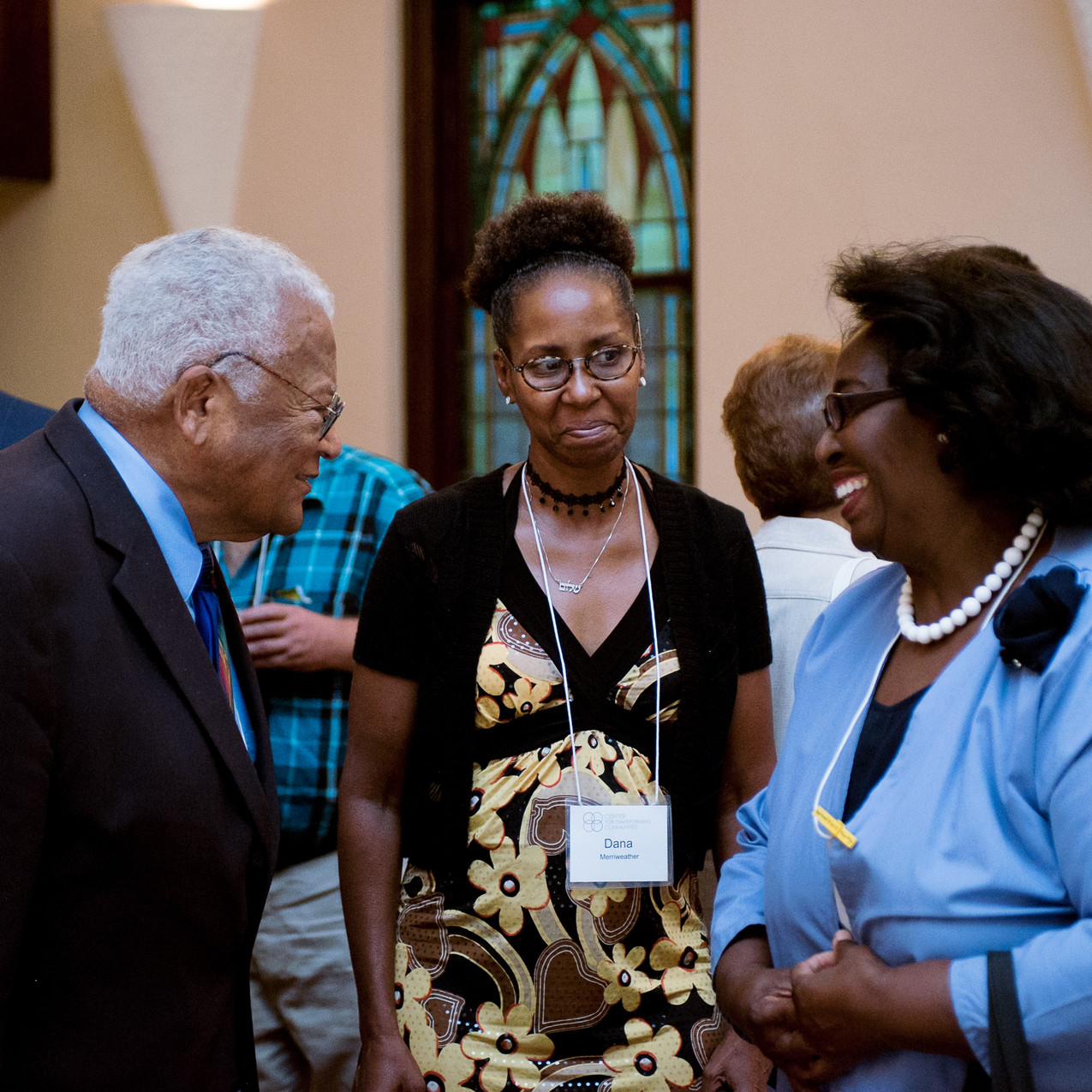 James Lawson visits with Shalom Zone leaders Dana Merriweather and Judy Conway.