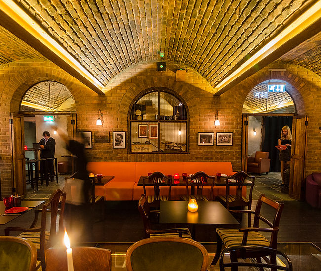 Copa De Cava, St Pauls London. Brick vaulted wine cellar inteior