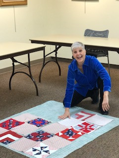 Pam Farago arranging squares from members