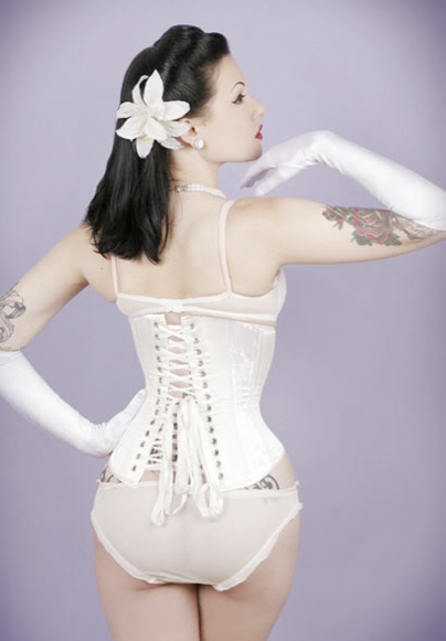 image of a corset that is too small in the hips