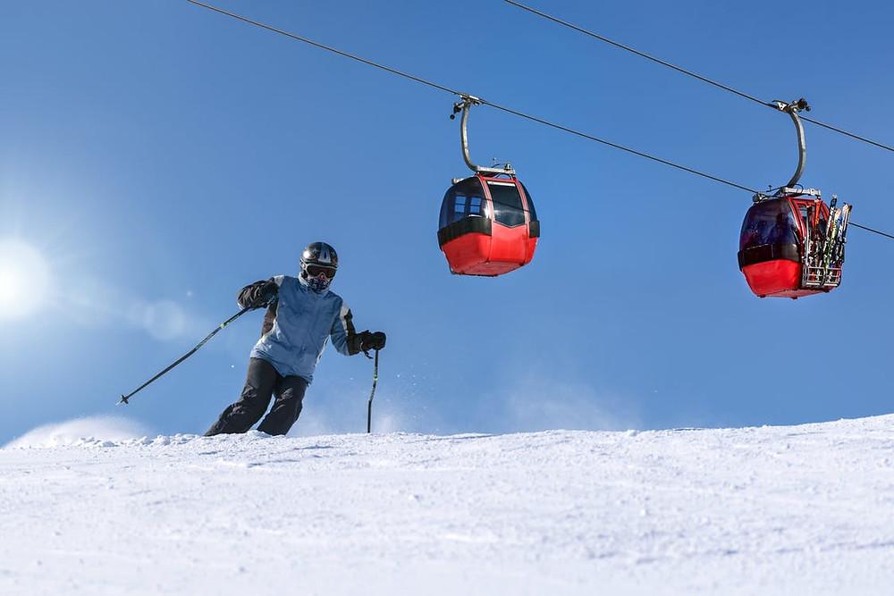 Person Riding Ski on Snow Field