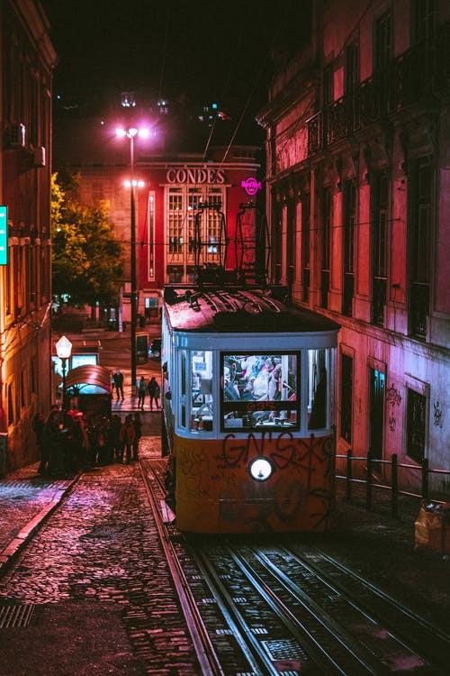 People Riding Tram at Night