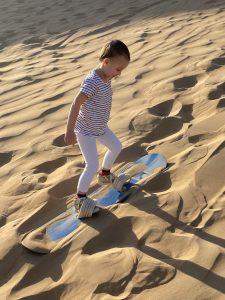 girl sand boarding